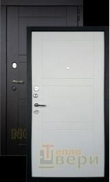Тепломакс Черный муар/Беленый дуб металлическая входная дверь